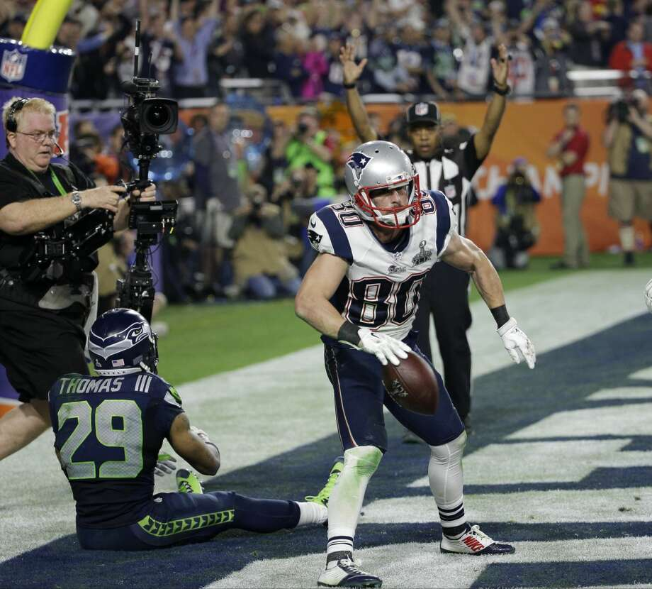 New England Patriots wide receiver Danny Amendola (80) celebrates his four-yard touchdown catch during the second half of NFL Super Bowl XLIX football game against the Seattle Seahawks Sunday, Feb. 1, 2015, in Glendale, Ariz. (AP Photo/David J. Phillip) Photo: David J. Phillip