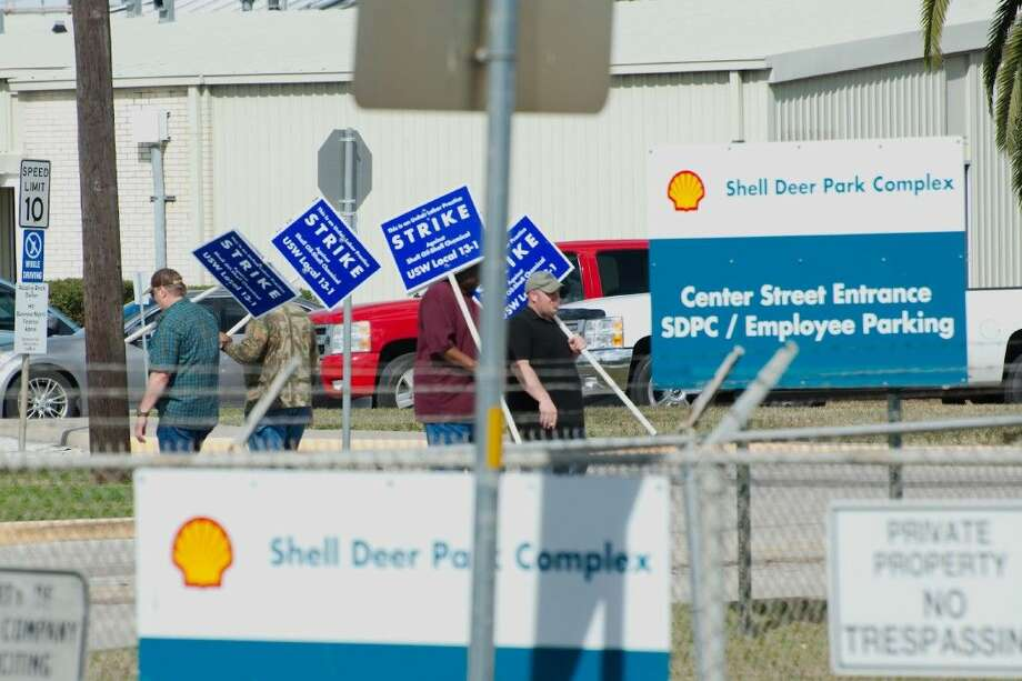 Representatives from Deer Park United Steelworkers Local 13-1 hold picket signs outside the Shell Deer Park Refinery as the Union calls for strikes against the Shell refinery and chemical plants in Deer Park Sunday. Photo: Kirk Sides