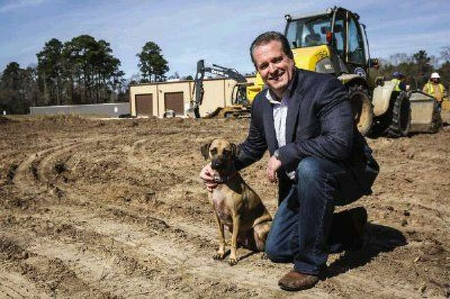 Saddle River Range Owner Thomas Bolsch visits the construction site of his new building with his tracking dog Tracc. Work on the site of the 33,000-square-foot building started this week.