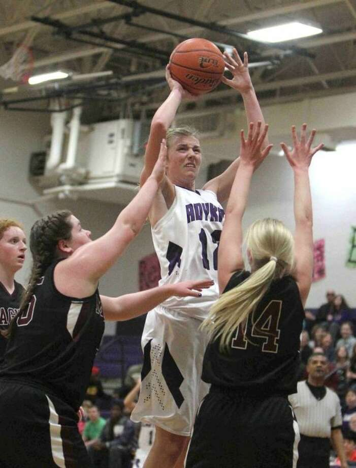 Willis' Haley Sellers goes up for a shot against Magnolia. The Lady Bulldogs' Jessica Bruti, left, and Haley Ridley (14) defend. Willis edged Magnolia 39-34. To view or purchase this photo and others like it, visit HCNpics.com. Photo: Jason Fochtman