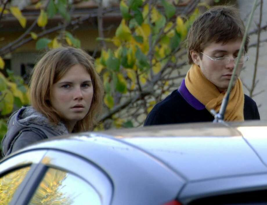 In this Friday Nov. 2, 2007 file photo Amanda Knox, left, and Raffaele Sollecito, stand outside the rented house where 21-year-old British student Meredith Kercher was found dead in Perugia, Italy.