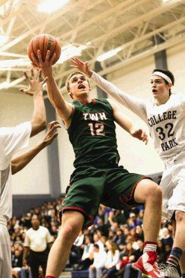 Woodlands' Cameron Burkett (12) goes for a layup as College Park's Brett Reed (32) guards during the high school boys basketball game on Jan. 9, 2015, at College Park High School. To view or purchase this photo and others like it, go to HCNPics.com. Photo: Michael Minasi