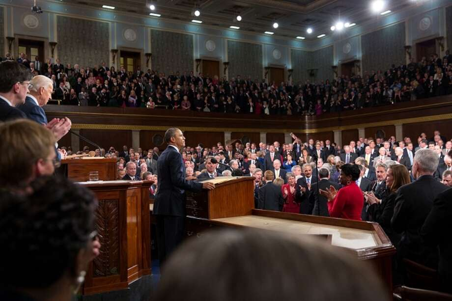 President Barack Obama acknowledges the applause before he delivers the State of the Union address in the House Chamber at the U.S. Capitol in Washington, D.C., Jan. 28, 2014. Photo: Official White House Photo By David Lienemann