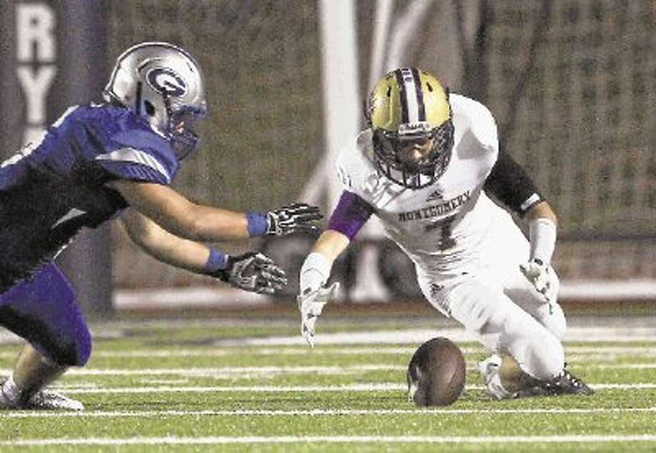 Montgomery's Austin Champion dives for a fumble in a Region III-4A bi-district playoff game against Georgetown in November. The Bears are expected to move into Class 6A, the new highest classification in Texas, when the UIL announces realignment for the 2014-15 and 2015-16 school years on Monday. Photo: Staff Photo By Jason Fochtman / @WireImgId=2651196