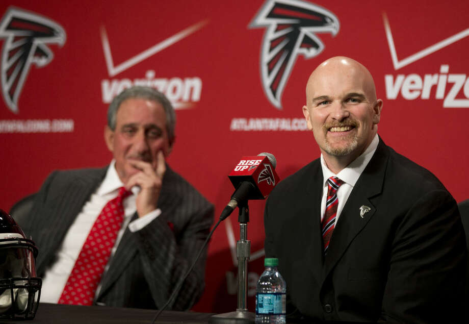 Former Seattle Seahawks defensive coordinator Dan Quinn, right, and Atlanta Falcons owner Arthur Blank laugh as a reporter asks a question during a news conference introducing Quinn as the new head coach of the Atlanta Falcons NFL football team, Tuesday, Feb. 3, 2015, in Flowery Branch, Ga. (AP Photo/John Bazemore) ns Tuesday, Feb. 3, 2015, Ga. (AP Photo/John Bazemore) Photo: John Bazemore