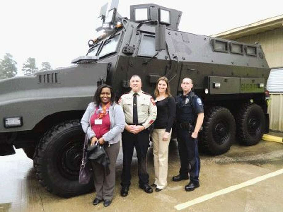 The Leadership Montgomery County Class of 2014 enjoyed a day of learning about public safety and criminal justice at the LMC Public Safety Session sponsored by the city of Conroe. Left to right are LMC class member Sharon Lavery, of Praxair Inc.; session director Lt. Brady Fitzgerald, of the Montgomery County Sheriff's Office; LMC class member Natalie Saikowski, of Woodforest National Bank; and Conroe Police Officer Jarod Sullivan.