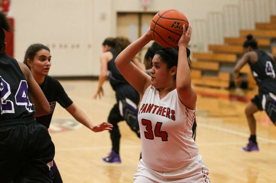 Caney Creek's Lesli Guerrero (34) passes the ball during the high school girls basketball game against Willis on Tuesday, Jan. 12, 2016, at Caney Creek High School. To view more photos from the game, go to HCNPics.com. Photo: Michael Minasi