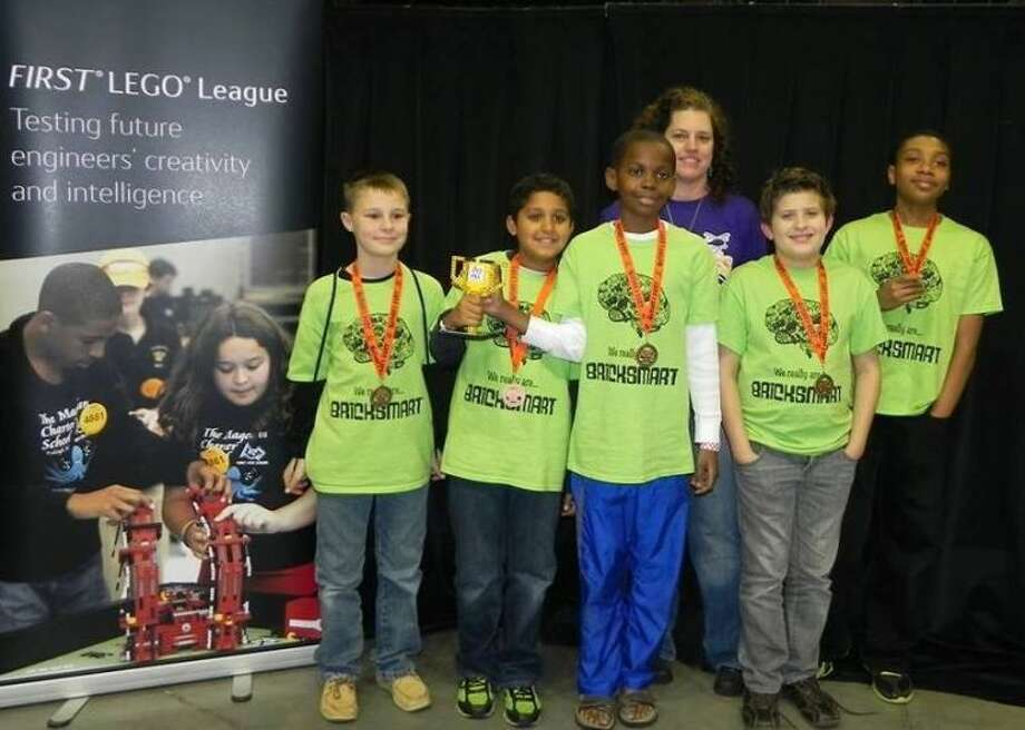 The BrickSmart team consists of five boys who attend different schools in The Woodlands, Magnolia and Conroe. From left to right are Weston Coleman, Kabir Jolly, Tani Bassir, Devin McGuyer and Tobi Soares, and their coach is Katie Kelley.