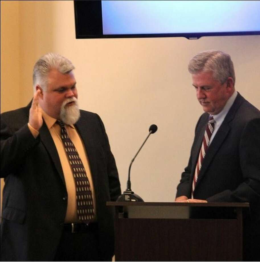 Gregg Hope, left, takes the oath of office from County Judge Craig Doyal as a member of the Lone Star Groundwater Conservation District Board of Directors. He replaces Sam Baker who resigned due to an increased workload.