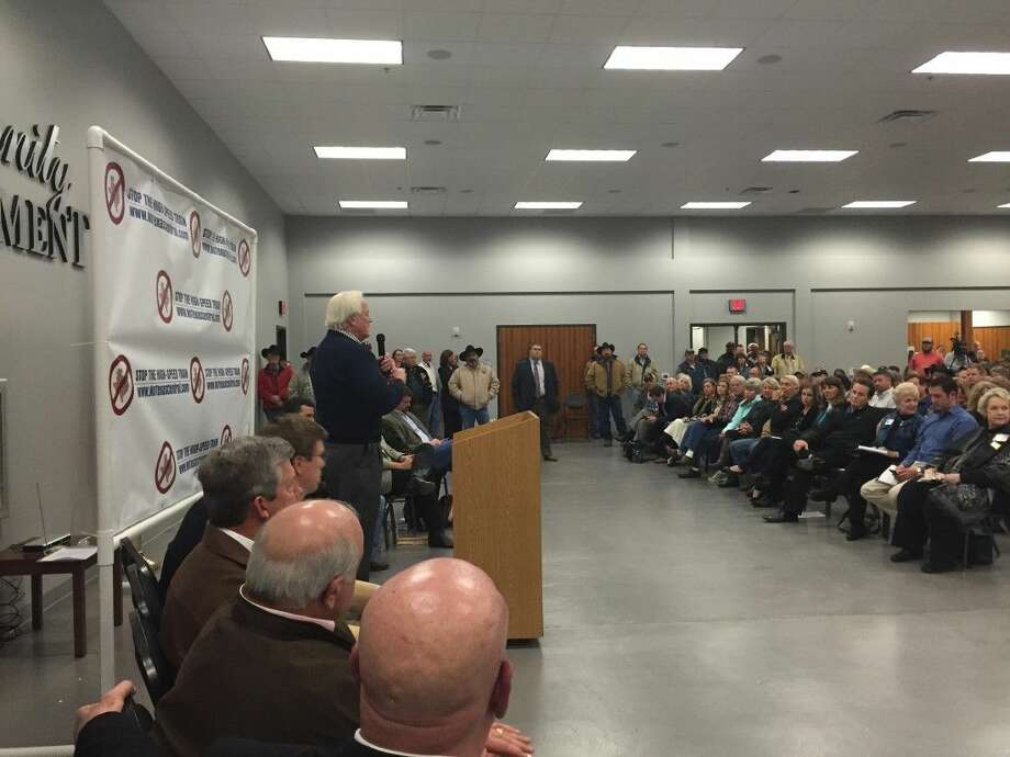 More than 800 people packed the Lone Star Community Center in Montgomery Monday night in opposition of a high-speed-rail project that will cut through western Montgomery County.