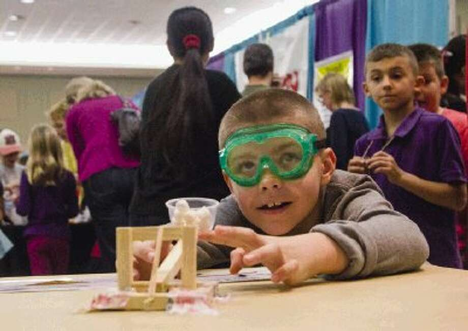 Ann K. Snyder Elementary School student Nick Moylan, eight, tests out a marshmallow catapult during Saturday's Elementary School Science Festival in the second day of events at the SCI://TECH Exposition hosted by Education for Tomorrow Alliance in the Lone Star Convention & Expo Center in Conroe. The annual event is the largest science fair in Texas and one of the largest regional science fairs in the country. To view or purchase this photo and others like it, visit HCNpics.com. / The Conroe Courier/ The Woodland