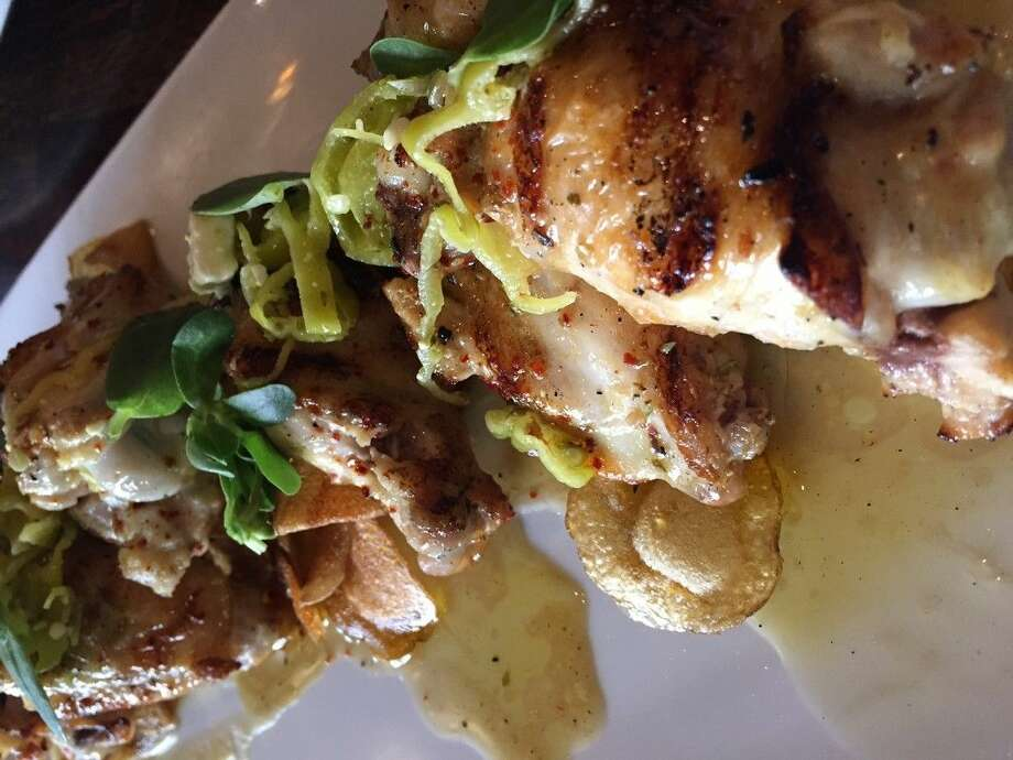 The Grilled Feta-Brined Chicken at Helen is a favorite - a Greek take on our beloved Texas wings. Photo: Courtesy Photo