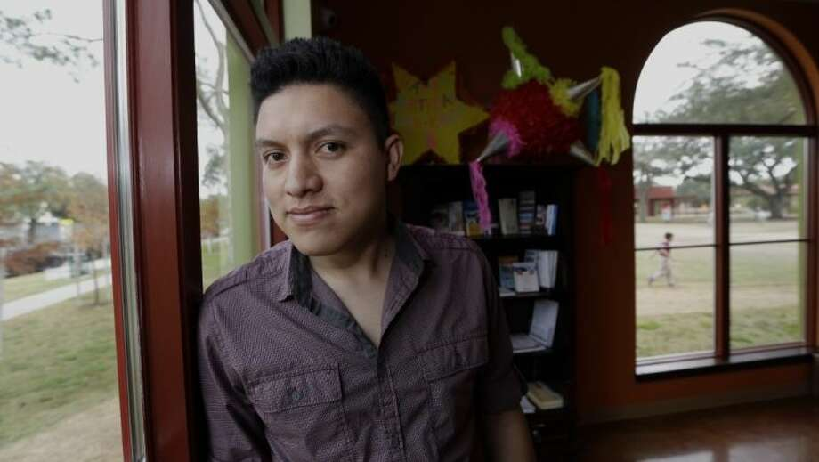 Manuel Enrique Angel, 28, of El Salvador, poses in Houston Wednesday, Dec. 4, 2013. Angel made learning English his first priority upon arriving in Houston from his native El Salvador two years ago. He now speaks English clearly and deliberately and plans to apply for citizenship as soon as he becomes eligible later this year. He estimates it will take him up to eight months to save the money for the citizenship application. Photo: David J. Phillip