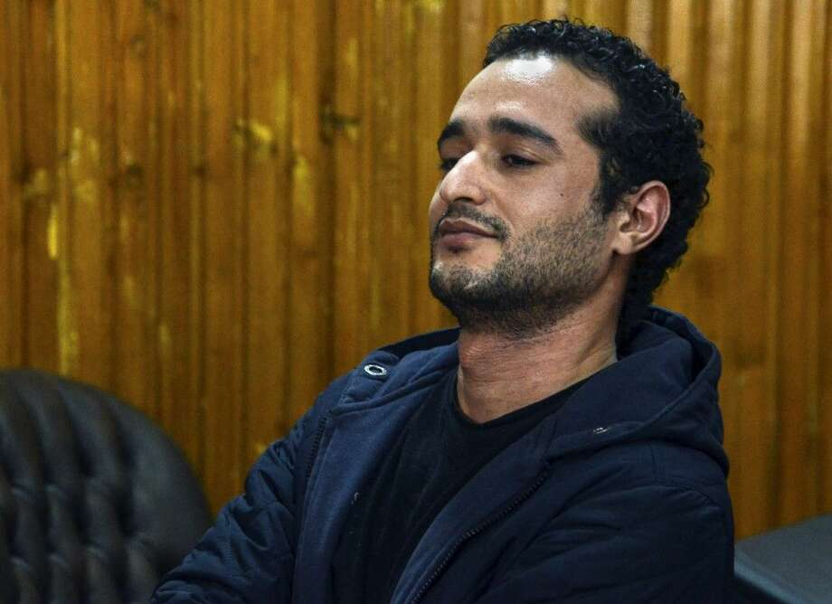 Ahmed Douma, one of the leading activists behind Egypt's 2011 uprising, attends a court hearing Wednesday in a courtroom of Torah prison in Cairo. Photo: Mohammed El-Raaei