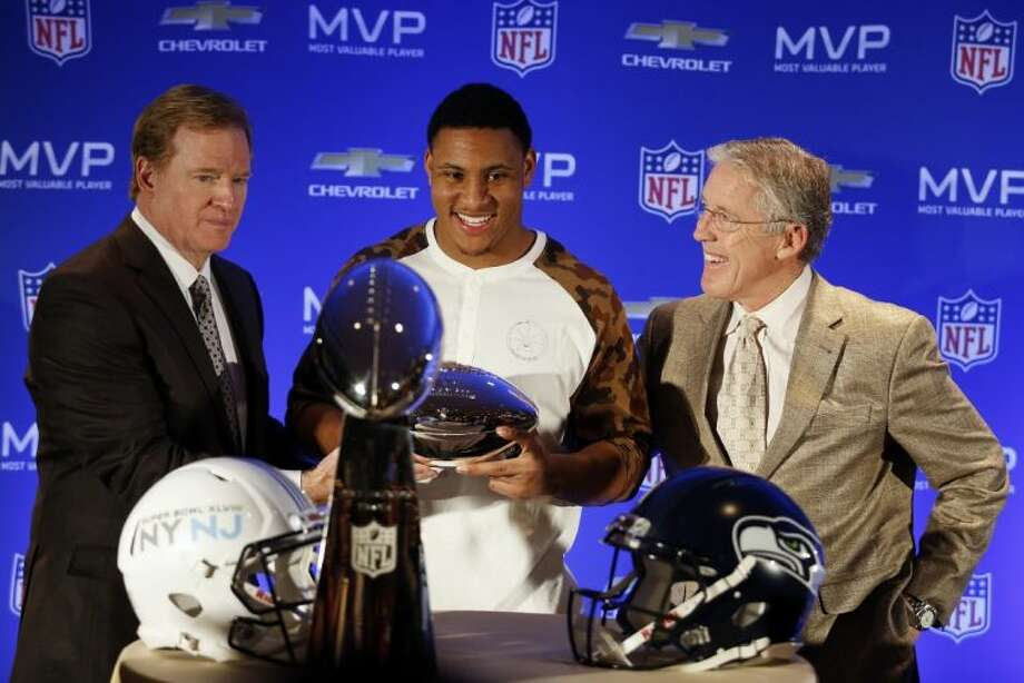 NFL commissioner Roger Goodell poses with Super Bowl MVP Malcolm Smith and Seahawks coach Pete Carroll, right. Photo: Doug Benc