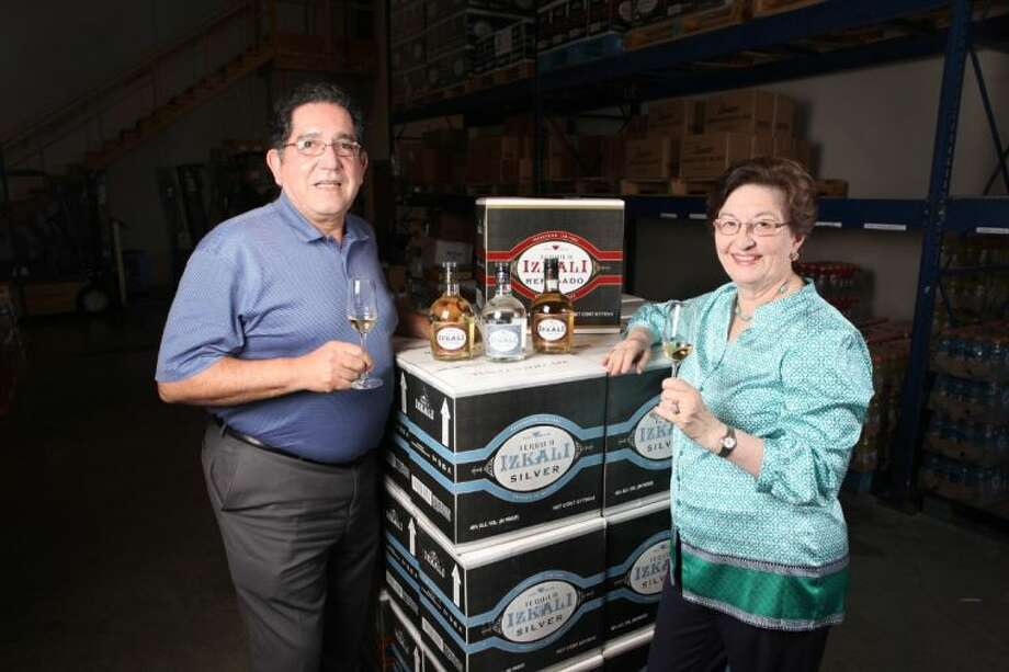 Ignacio and Nydia Flores with their Izkali Tequila in their warehouse in Stafford. Photo: Photo By Alan Warren