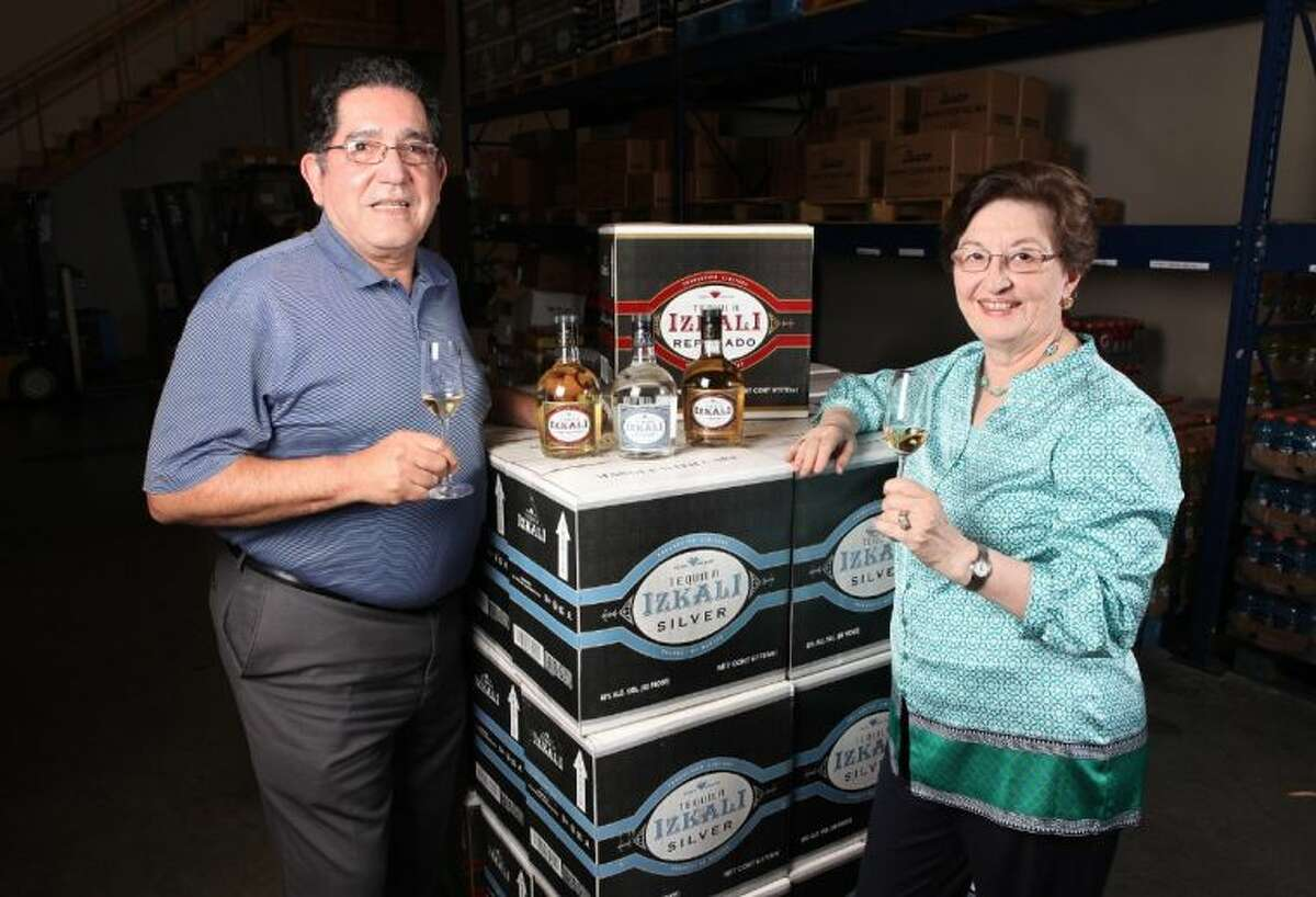Ignacio and Nydia Flores with their Izkali Tequila in their warehouse in Stafford.