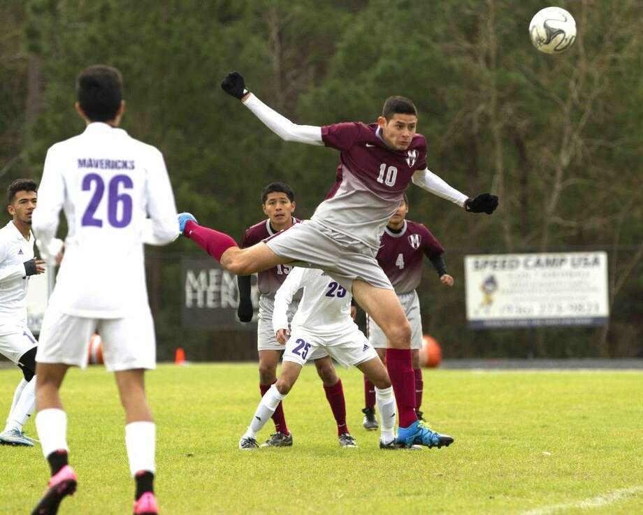 Magnolia's Oscar Aragon (10) heads the ball during the first half of a soccer match Saturday. Magnolia tied Morton Ranch 3-3. To purchase this photos, and others like it; got to HCNpics.com Photo: Jason Fochtman