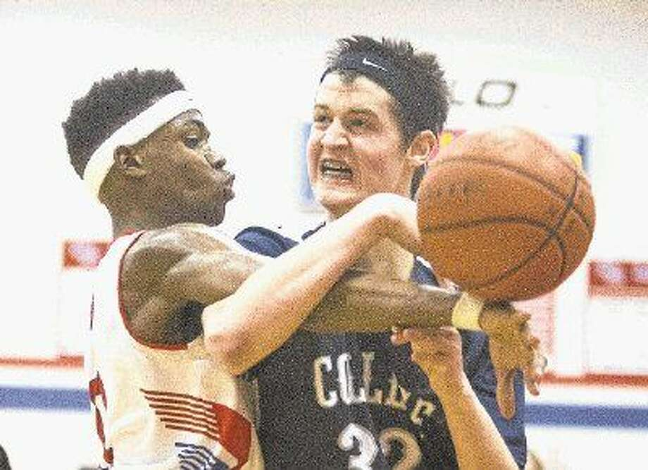 College Park's Brett Reed is fouled by Oak Ridge's Darius Love during a high school basketball game on Jan. 13. To view or purchase this photo and others like it, visit HCNpics.com.