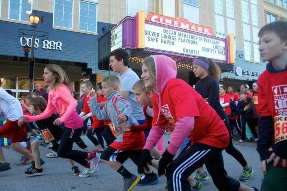Hundreds of children participated in the Kids Running for Kids event in 2013. Now in its third year, the race to help raise money to purchase books for underprivileged students is set for Saturday at Market Street.