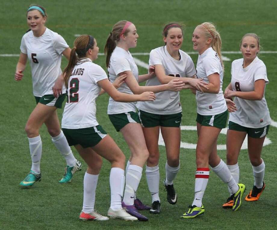 The Woodlands' Stephanie Evans celebrates with teammates after scoring a goal in the second half on Tuesday at Woodforest Bank Stadium. To view or purchase this photo and others like it, visit HCNpics.com. Photo: Jason Fochtman