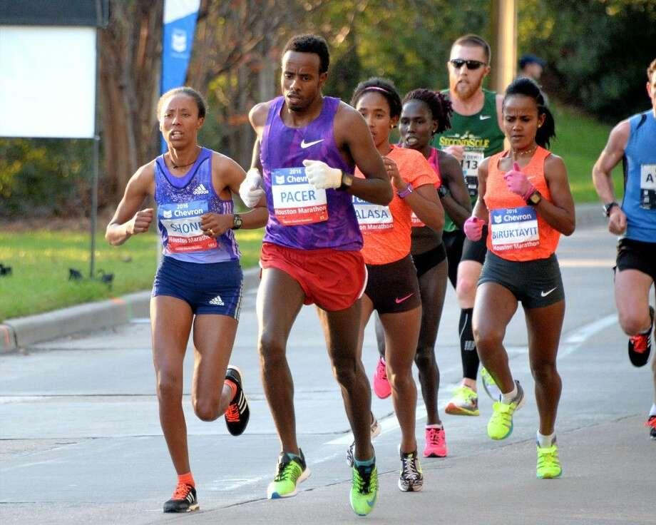 Runners at Milepost 14 of the Chevron Houston Marathon along Post Oak Blvd, Houston on Sunday. Photo: Craig Moseley