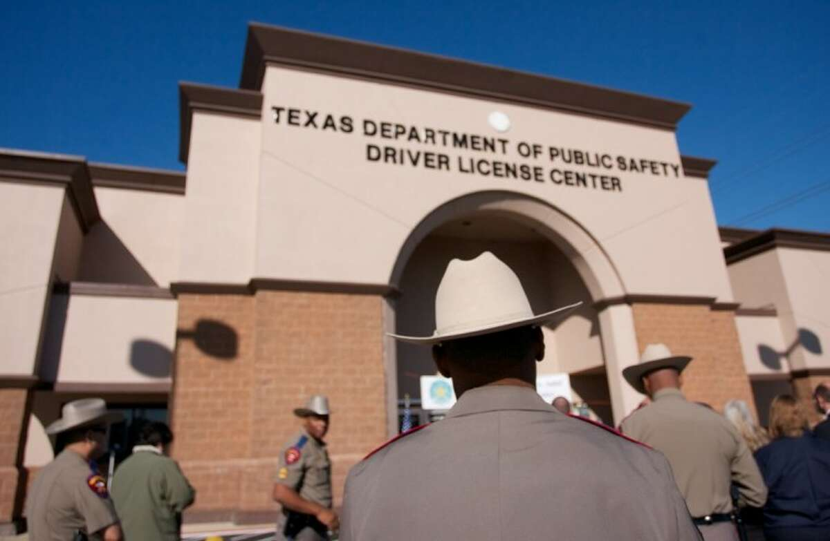 A Texas Department of Public Safety trooper is seen in front of the new Texas DPS Spring Drivers License Mega Center at 4740 Spring Cypress Road.