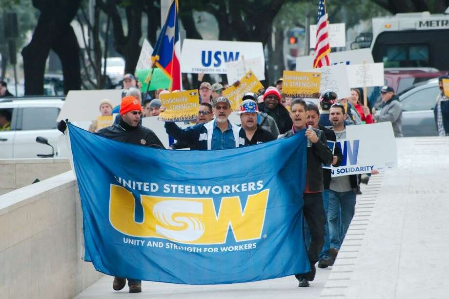 Representatives of the United Steelworkers union march during a rally Friday at Shell headquarters in Houston. Photo: Kirk Sides