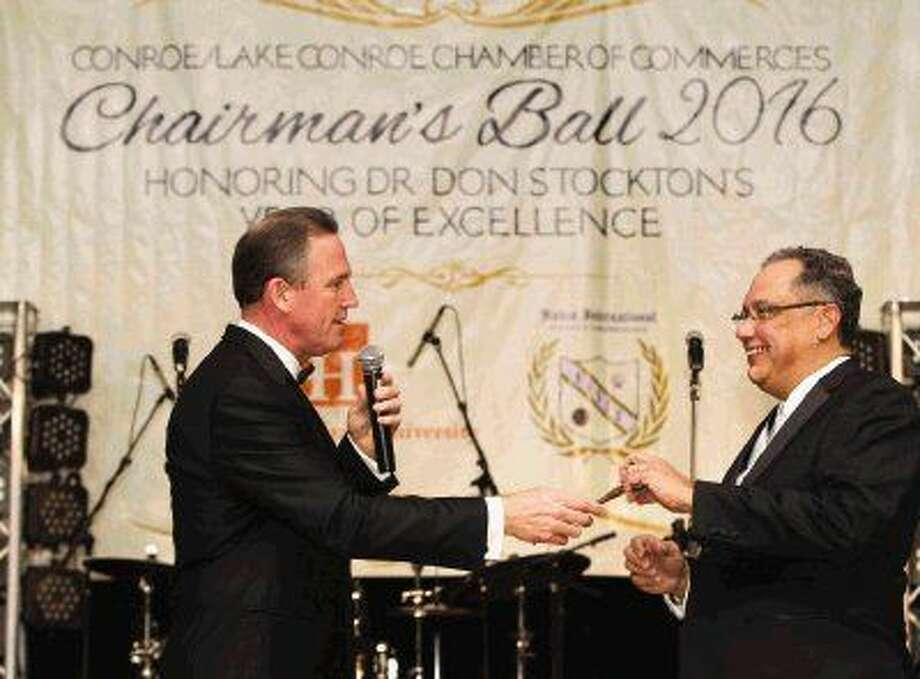Dr. Don Stockton, outgoing chair-elect for the Conroe/Lake Conroe Chamber of Commerce, hands the gavel to Willis City Manager Hector Forestier, incoming chair-elect, during the Chamber's annual Chairman's Ball at La Torretta Lake Resort & Spa Saturday. Photo: Jason Fochtman