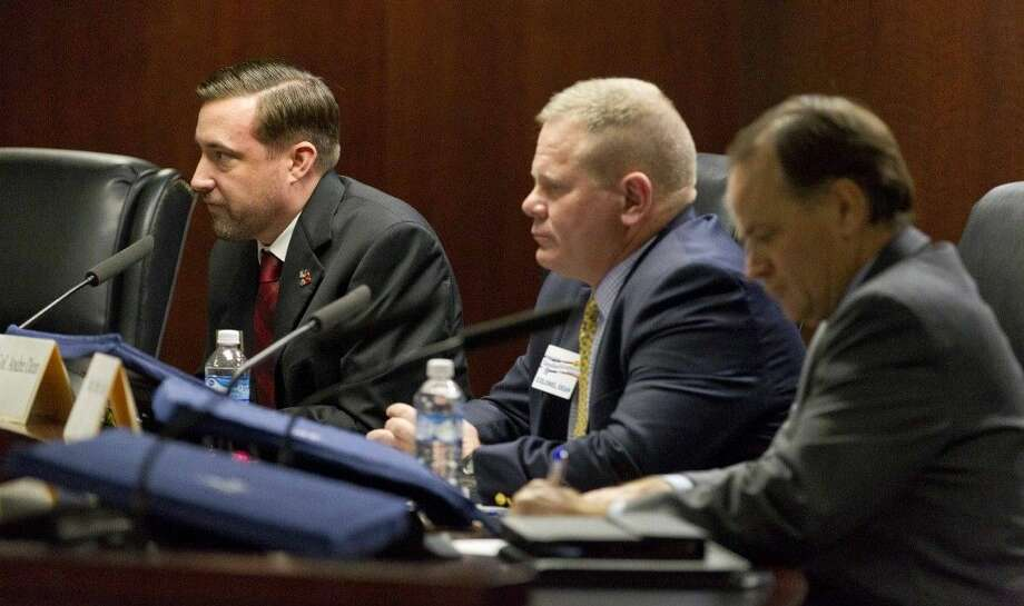 Craig McMichael, Andre Dean and Steve Toth deliver their opening statements during the Montgomery County Eagle Forum Thursday. Incumbent Kevin Brady did not attend the forum due to other committments. Photo: Jason Fochtman