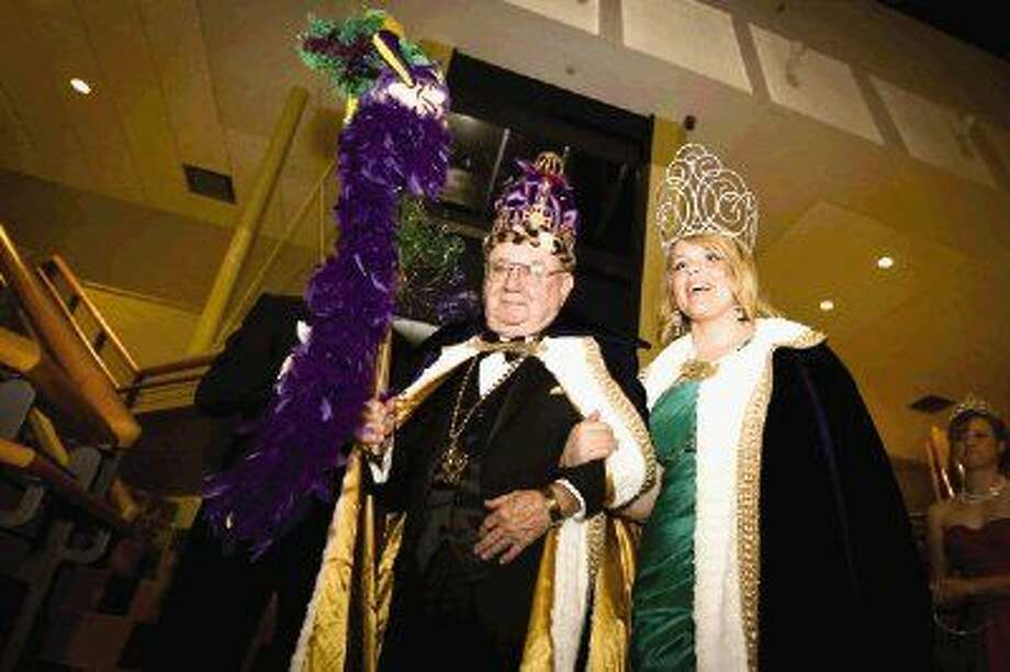 Mardi Gras king Lee Pruitt and queen Madeleine Ream descend the stairs after being crowned during the Montgomery County Performing Arts Society's sixth annual Mardi Gras Ball on Saturday at La Torretta Lake Resort and Spa. To view or purchase this photo and others like it, visit HCNPics.com. Photo: Michael Minasi