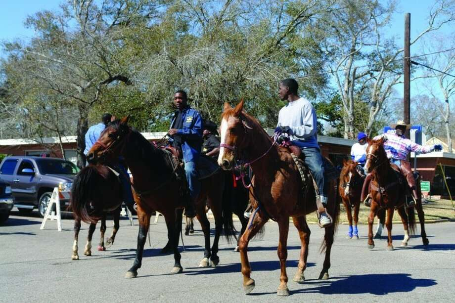 Parade participants ride horses in last year's Black History Parade. This year the event will be Saturday.