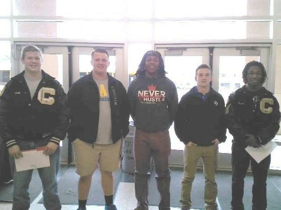 Five Conroe football players signed national letters of intent on Wednesday. They include, from left, guard Cody Brown (Lamar), center T.J. Anderson (Southern Arkansas), running back Dontrell Dock (McMurray), kicker/punter Cordell Vogel (Stephen F. Austin) and wide receiver Darrian Dock (McMurray).