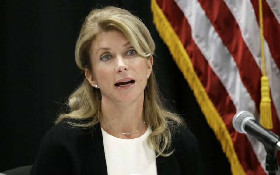 In this Jan. 9, 2014 file photo, Texas Sen. Wendy Davis speaks at an education roundtable meeting in Arlington, Texas. Davis, who has said she would support expanding gun rights, now says that includes allowing concealed handgun license holders to openly carry their weapons in public. Photo: LM Otero