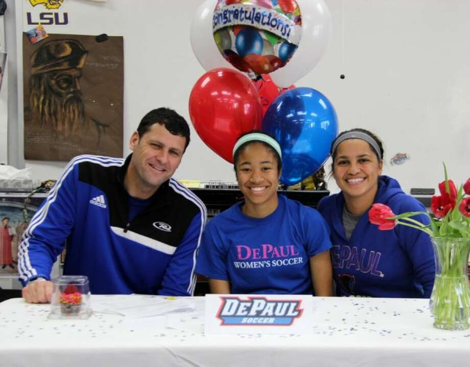 Cooper soccer player Sonia Johnson signed with DePaul University on Wednesday.