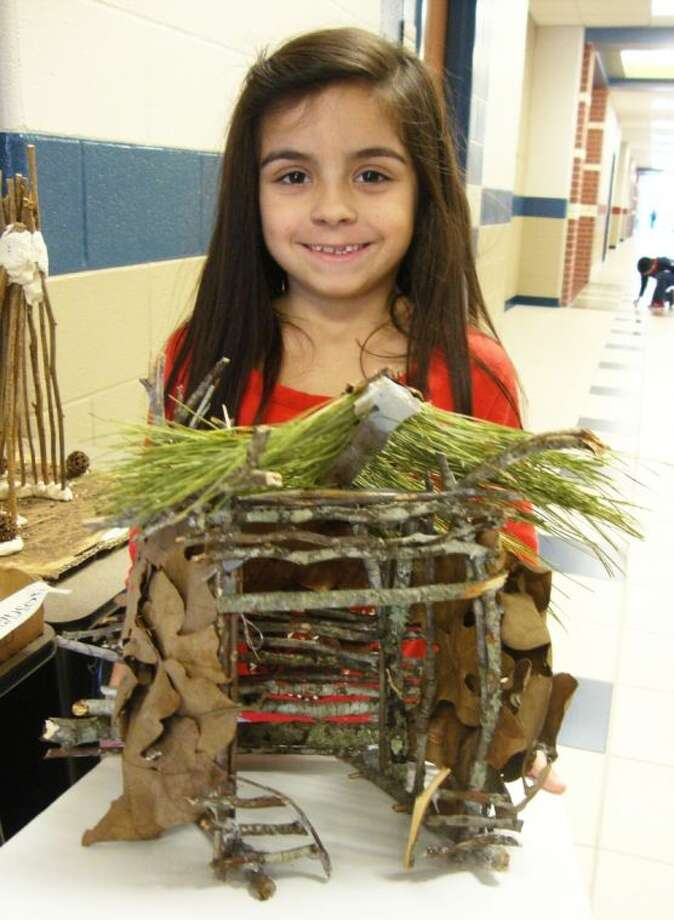 A Wilkinson second- grader posed with her natural resource projects.