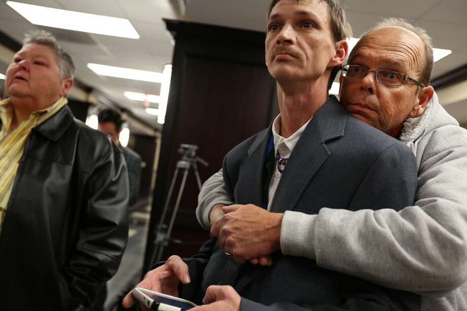John Humphrey, left, and James Strawser wait for a marriage license Tuesday along with several other gay couples at the Mobile County Probate office in Mobile, Ala. Photo: Sharon Steinmann