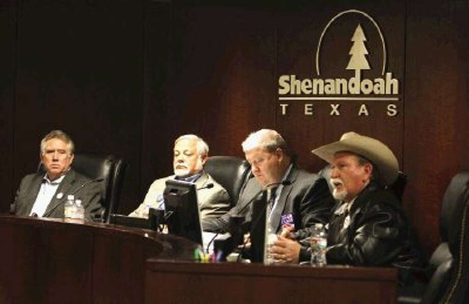 "Montgomery County Commissioner - Precinct 4 candidates Clarence Quinn, Bob Bagley, Jim Clark and Roland ""Red"" McCleskey take part in a candidate forum in Shenandoah Thursday. / Conroe Courier / HCN"