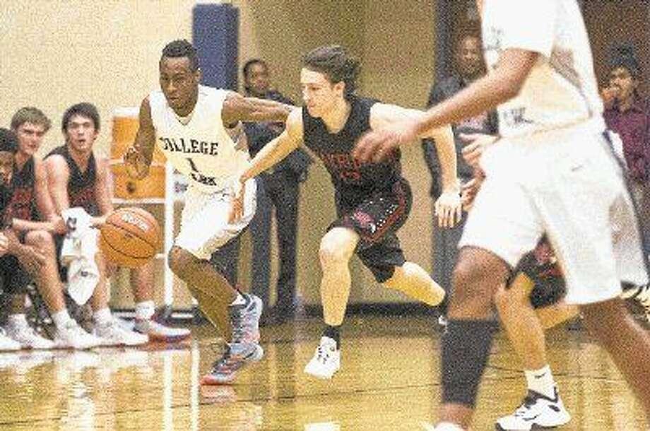 College Park guard Mckinley Green battles Oak Ridge power forward Darius Alford for a loose ball during a basketball game recently. Photo: Jason Fochtman