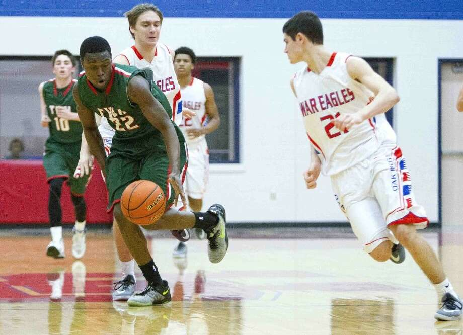 The Woodlands' Romello Wilbert starts a fast break during a high school girls basketball game Tuesday. Wilbert's 17 points lead the Highlanders to a 50-35 win that clinched the district's last playoff spot. To view or purchase this photo and others like it, visit HCNpics.com. Photo: Jason Fochtman