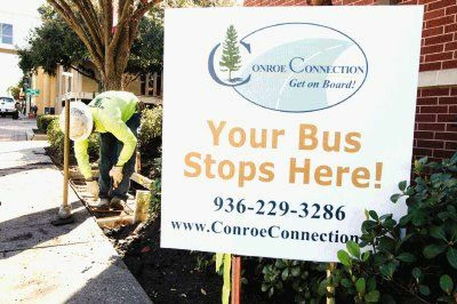 The city of Conroe has placed temporary signs along the bus route for the new Conroe Connection system. Photo: Jason Fochtman