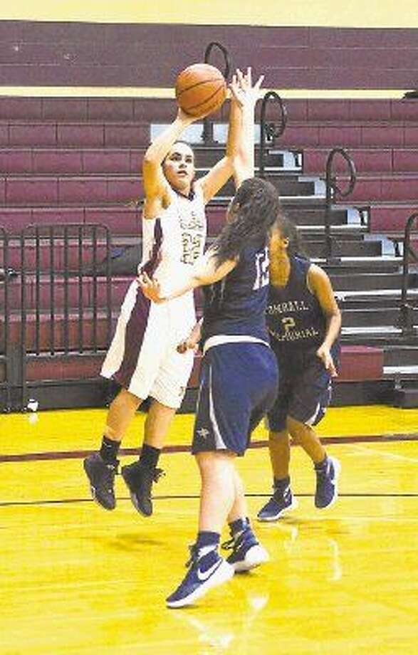 Magnolia West junior guard Lauren Martinez puts up a shot against Tomball Memorial.