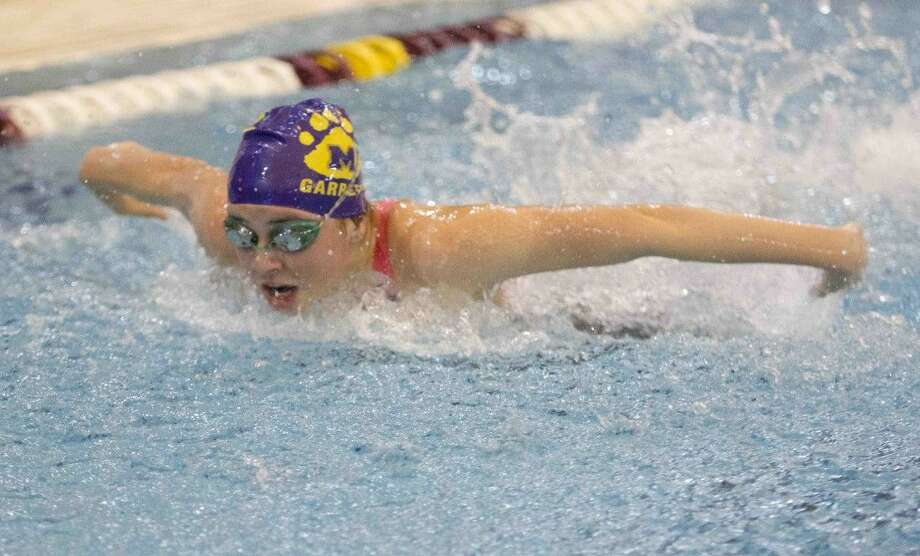 Montgomery's Rylee Garrett competes in the girls 200-yard IM during the prelims of the Region IV-6A Swimming and Diving Championships Friday. To view or purchase this photo and others like it, visit HCNpics.com. Photo: Jason Fochtman