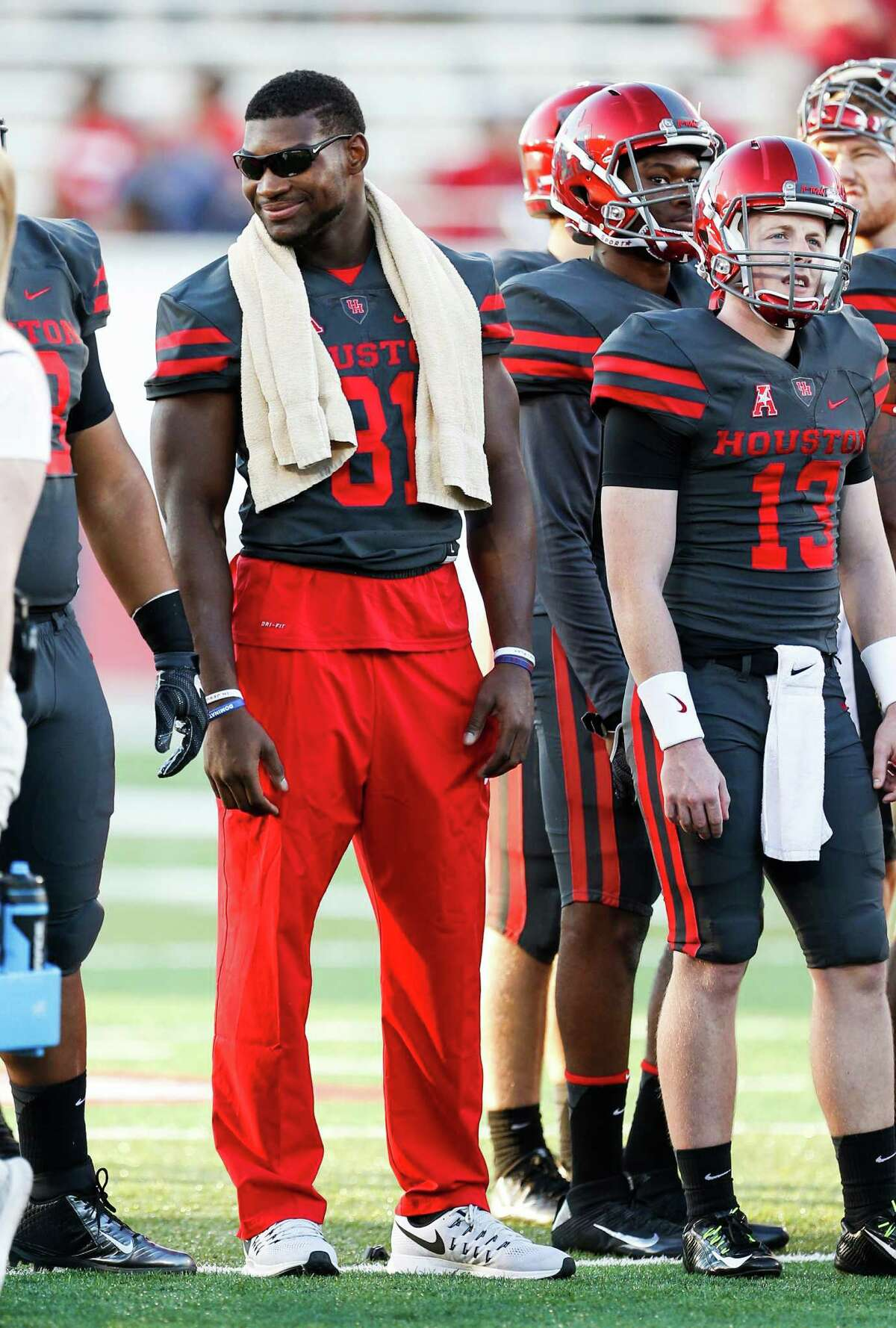 Houston linebacker Tyus Bowser (81) stands on the side out of uniform before an NCAA football game against Connecticut at TDECU Stadium on Thursday, Sept. 29, 2016, in Houston.