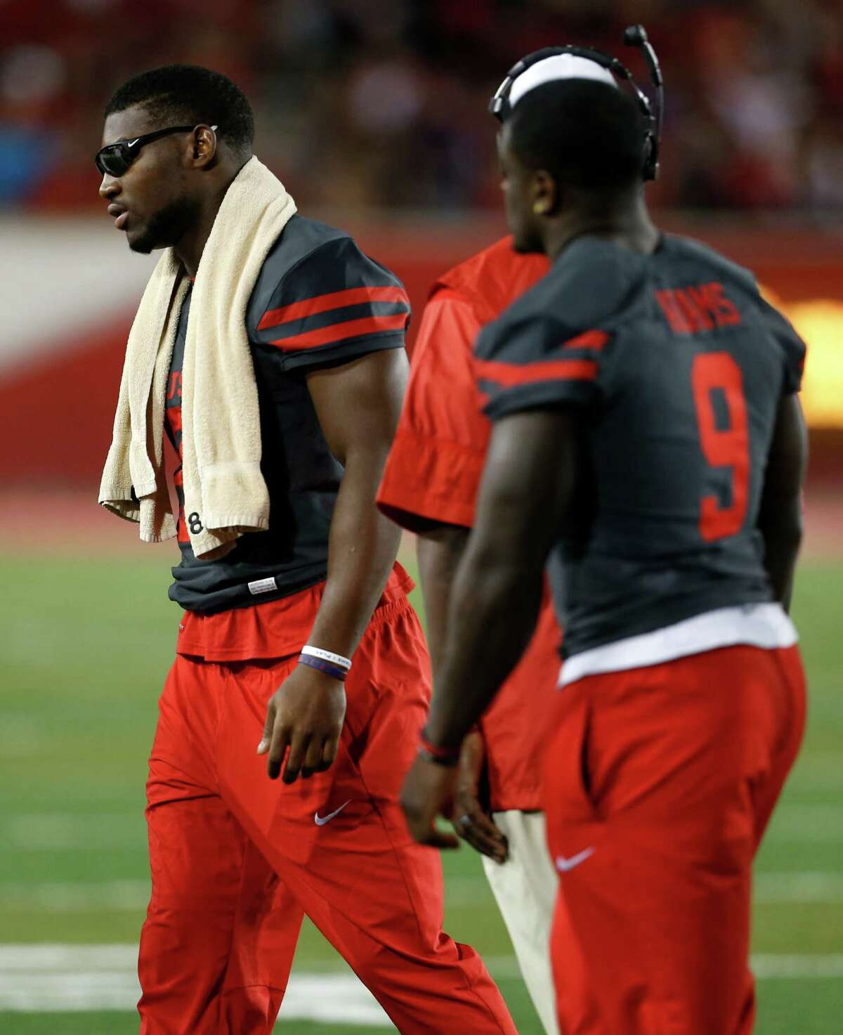 Houston linebacker Tyus Bowser (81) and linebacker Matthew Adams (9) walk off the field following a time out against Connecticut during the first half of an NCAA football game at TDECU Stadium on Thursday, Sept. 29, 2016, in Houston.