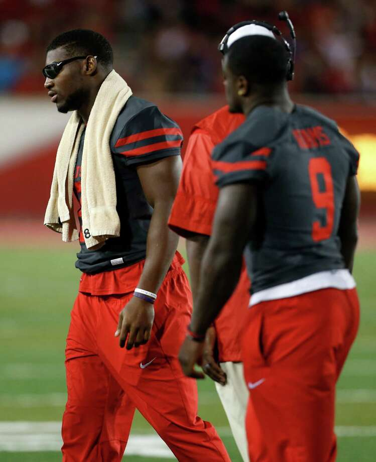 Houston linebacker Tyus Bowser (81) and linebacker Matthew Adams (9) walk off the field following a time out against Connecticut during the first half of an NCAA football game at TDECU Stadium on Thursday, Sept. 29, 2016, in Houston. Photo: Brett Coomer, Houston Chronicle / © 2016 Houston Chronicle