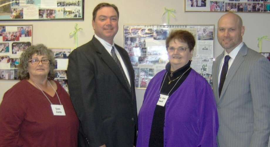 Pictured from left to right are Dana Jordy, NMCRTA President; Dr. Beau Rees, Montgomery ISD Superintendent; Sue Ann Powell, Retirement Education Chairman; and Tim Harkrider, Willis ISD Superintendent.