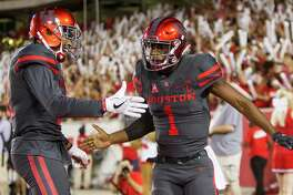 Houston quarterback Greg Ward Jr. (1) and Chance Allen (21) celebrate Ward's 30-yard touchdown run against Connecticut during the second quarter of an NCAA football game at TDECU Stadium on Thursday, Sept. 29, 2016, in Houston.