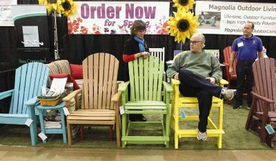 Mark Woodward tests out a chair from Magnolia Outdoor Living during the Lake Conroe Home & Garden Show at The Lone Star Convention & Expo Center in Conroe on Saturday. / Conroe Courier