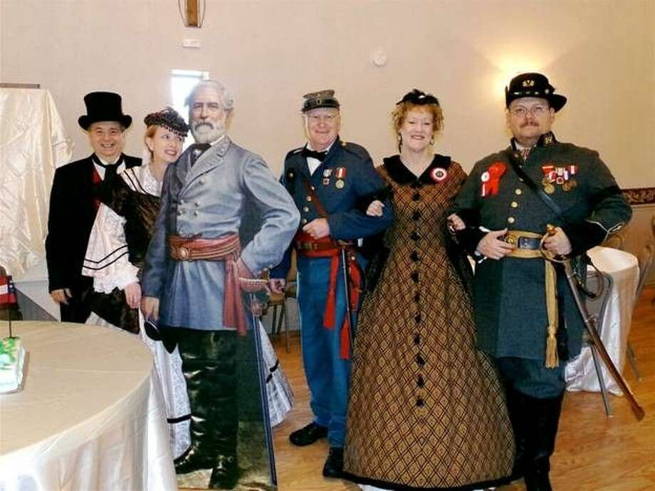 The Woodlands Chapter of Confederate Rose observed the birthday of General Robert E. Lee Jan. 18. Some attendees included members and husbands, from left: Tom Kernan; Renee Kernan (President of the Woodlands Rose Chapter, Order of the Confederate Rose); cutout of General Lee; Bob Mennell (Commander of the Major General Patrick Cleburne's 7th Texas Infantry SCV Camp); Sue Mennell and Kenneth Stewart (Chaplain for the Major General Patrick Cleburne's 7th Texas Infantry SCV Camp.)